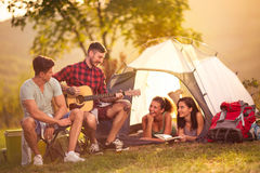 Romantic time two men singing girls in the tent Royalty Free Stock Images