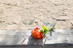 Romantic time with wine and rose flower Stock Image