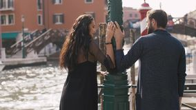 Romantic couple in Venice, Italy. Romantic tourist couple talking and looking to each other on pier in Venice, Italy. Back view. Beautiful view on bridge stock video