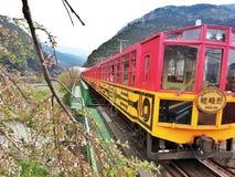 Famous red and yellow retro Romantic train. Arashiyama romantic train with Sakura blossoms Stock Images