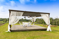 Romantic tranquil scene with pergola on the hill Stock Image