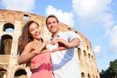Romantic travel couple in Rome by Colosseum, Italy Stock Photo
