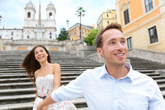 Romantic travel couple, Spanish Steps, Rome, Italy. Romantic travel couple on Spanish Steps, Rome, Italy holding hands in love. Young interracial couple walking Royalty Free Stock Photo