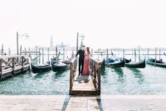 Romantic travel couple in Venice on Gondole ride romance in boat happy together on travel vacation holidays. Romantic young beauti royalty free stock photos
