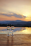 Romantic travel in thailand. Champagne glass on mountain background in sunset Stock Photography