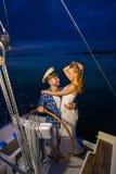 Romantic trip on a yacht. Stock Photo