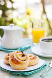 Romantic tropical breakfast Danish pastry, coffee, juice. Summer background Stock Images