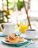 Romantic tropical breakfast Danish pastry, coffee, juice. Summer background Royalty Free Stock Photos