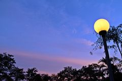 Romantic under round lamp. A romantic atmosphere with glow round evening lamp Stock Photo
