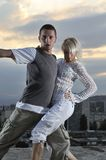 Romantic urban couple dancing outdoor. Romantic urban couple dancing on top of the bulding outdoor Royalty Free Stock Photo