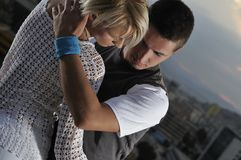 Romantic urban couple dancing outdoor. Romantic urban couple dancing on top of the bulding outdoor Royalty Free Stock Image