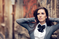 Romantic Urban Girl with Bowtie Accessory. Fashionable girl in melancholic state of mind Royalty Free Stock Photography