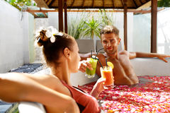 Romantic Vacation. Couple In Love Relaxing At Spa With Cocktails Royalty Free Stock Photography