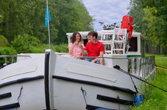 Romantic vacation, travel on barge boat, happy couple on river cruise in houseboat Royalty Free Stock Image