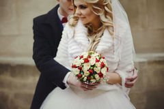 Romantic valentine hugging wife from behind roses bouquet closeup royalty free stock photos