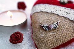 Romantic Valentine Plush Heart With A Winged Metal Heart On Ice Stock Photos