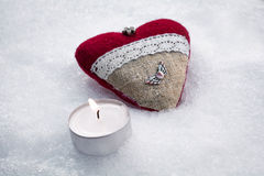 Romantic Valentine Plush Heart With A Winged Metal Heart On Ice Besides A Peaceful Tealight Stock Images