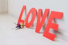 Romantic Valentine`s Day paper love inscription with flowers royalty free stock images