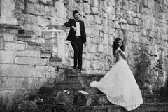 Romantic valentyne couple, bride and groom posing at destroyed o Stock Photo