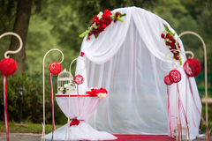 Romantic valentyne wedding aisle in a park with red decorations Stock Photography