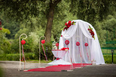 Romantic valentyne wedding aisle in a park with red decorations. And flowers royalty free stock photo
