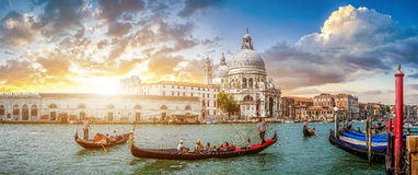 Romantic Venice Gondola scene on Canal Grande at sunset, Italy. Beautiful view of traditional Gondolas on famous Canal Grande with historic Basilica di Santa stock photography