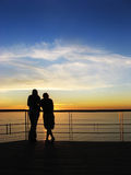 Romantic view. Portrait photo of a romantic couple at sunset royalty free stock photography
