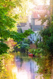 Romantic view of the canal with red boat in Bruges Stock Photo