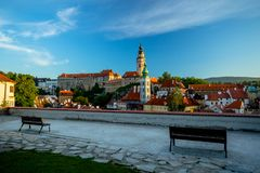 Romantic View of the Castle and Old Center in Cesky Krumlov with Two Benches. Romantic View of the Castle and Old Center in Cesky Krumlov on a Summer Sunny stock photo