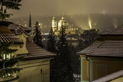 Romantic view of the night city of Prague in winter. Royalty Free Stock Photos
