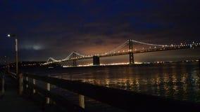 Romantic view of Oakland Bay Bridge at night. Romantic view of Oakland Bay Bridge with lights on in San Francisco, California stock footage