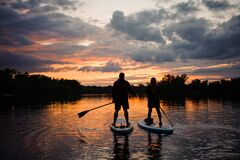 Free Romantic View On Man And Woman On Sup Boards Floating On River Stock Photos - 198118753