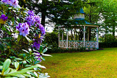 Romantic vintage gazebo in the garden. Vintage gazebo in the garden. Romantic wooden pergola in a green park Royalty Free Stock Photo