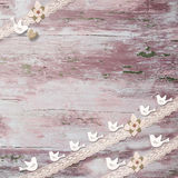 Romantic vintage invitation. Romantic card, little birds, heart and vintage lace on old pink wooden background with copy space Royalty Free Stock Image