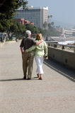 Romantic walk. Couple arm and arm royalty free stock photography