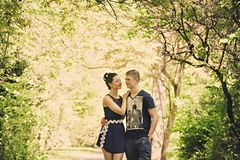 Romantic walk along the sunny path in the park Stock Image