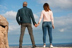 Romantic walk, man and woman in casual clothes hold hands Royalty Free Stock Photo