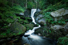 Romantic Waterfall inside the forrest Stock Photos