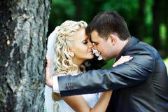 Romantic weddihg walk. Romantic kiss at wedding walk Royalty Free Stock Photos