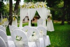 Romantic wedding ceremony. In forest Stock Photos
