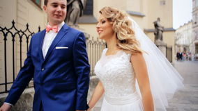 Romantic Wedding Concept Bride Holding Hand. Walking shot in slow motion stock video footage