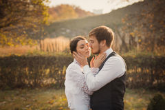 Romantic wedding couple embracing at each other Stock Photos