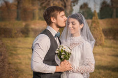 Romantic wedding couple embracing at each other Royalty Free Stock Photos