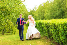 Romantic wedding couple having fun together outdoor in nature Stock Photos