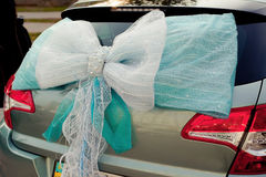 Romantic Wedding Decoration Ribbon on Car in Stock Photos