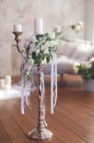 Romantic wedding flower bouquet with candlestick Stock Image