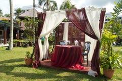 Romantic wedding pavilion. Romantic wedding table in resort tropical garden Royalty Free Stock Images