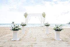 Romantic Wedding setting on the beach and blue sky. stock photography