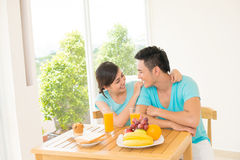 Romantic week-end. Copy-spaced image of a young couple having romantic breakfast of their weekend in the apartment Stock Photography