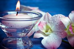 Romantic wellness. Wellness in romantic style with candle and beautiful flower orchid Royalty Free Stock Photos